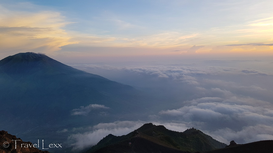 View of Mt Merbabu and the surrounding area at sunrise from Mt Merapi