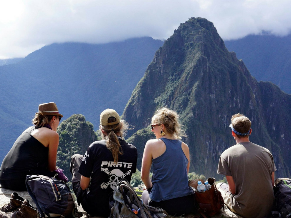 Solo travellers enjoy views of mountains