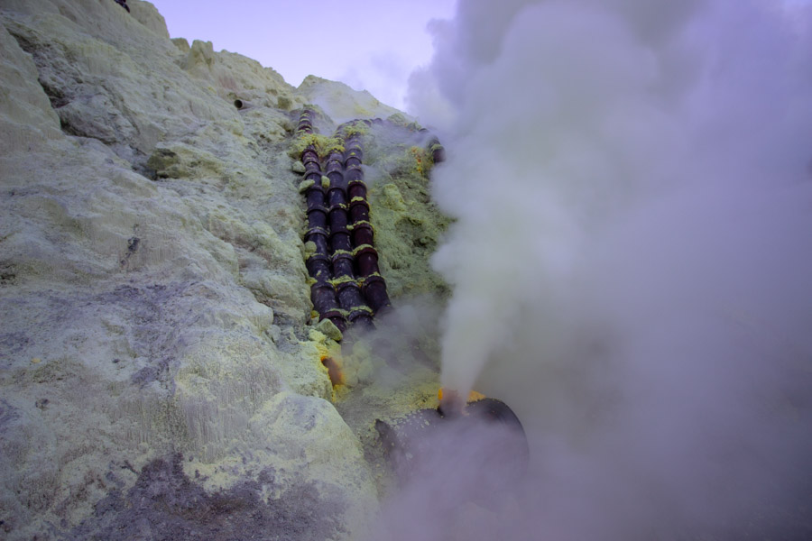 Ceramic pipes channel the sulphuric gases at Kawah Ijen crater