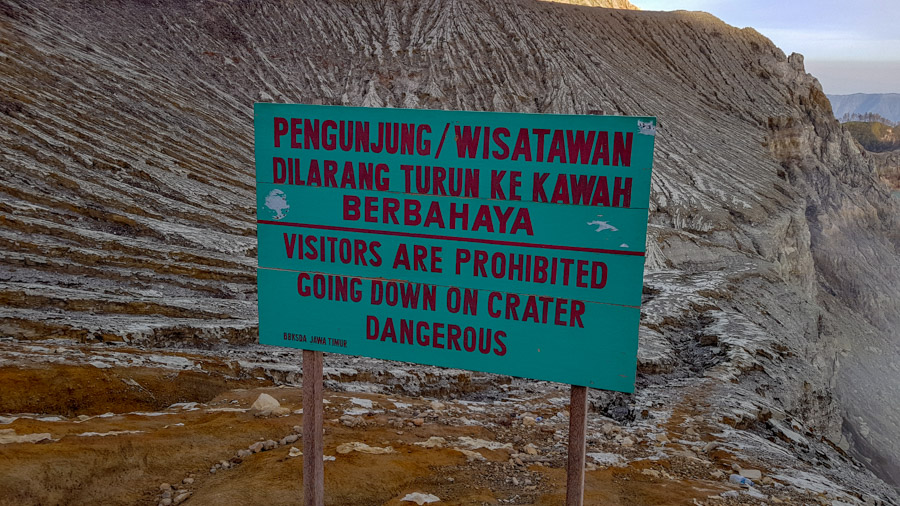 A sign warning of the dangers of the Kawah Ijen hike