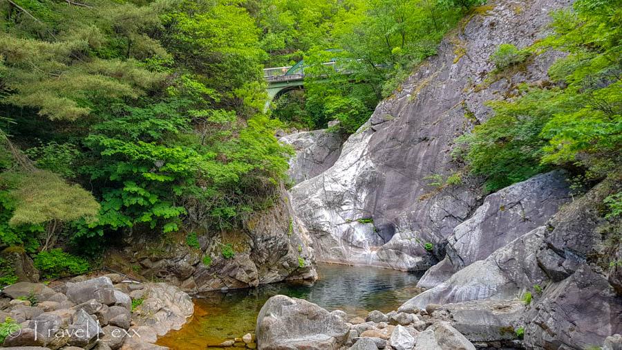 Darian Falls waterfall and a suspension bridge above