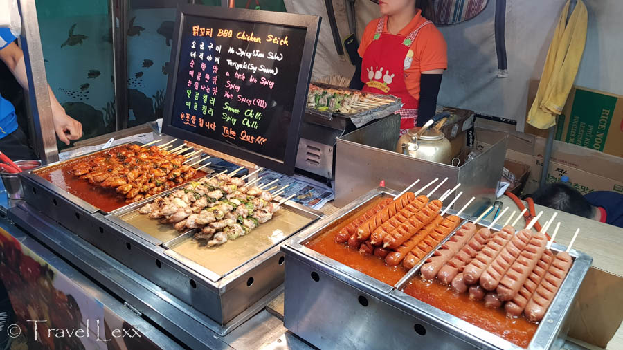 Rows of skewered chicken, meat and sausages at a street food stall in Seoul