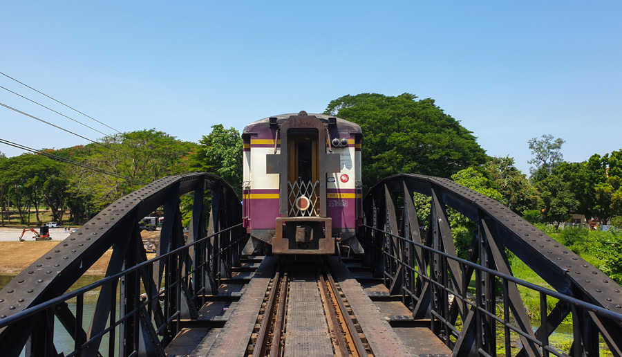 A train crossing a bridge on the way from Bangkok to Kanchanaburi