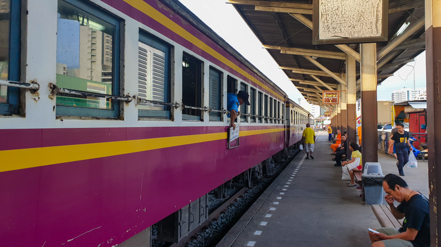 A train on a platform at Thonburi station