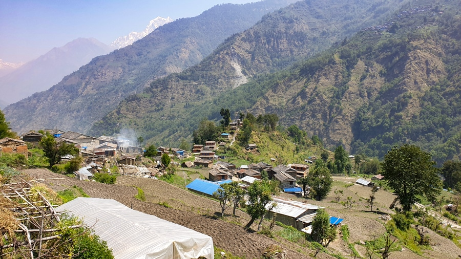 A view of a small village and the surrounding mountains between Tatopani and Ghorepani