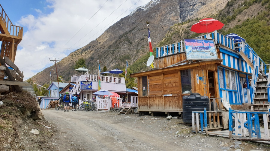 Wooden guesthouses in the village of Dhukur Pokhari