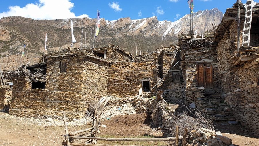 A group of stone houses in the village of Ghyaru with f