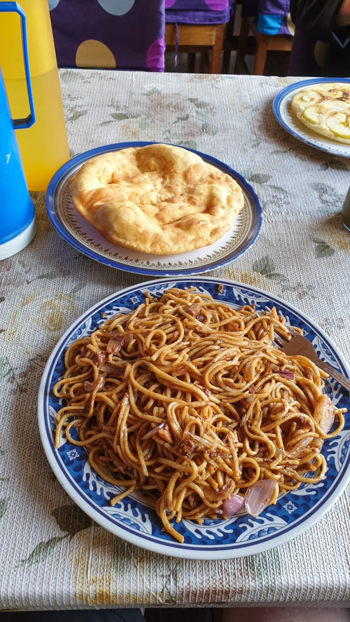 A plate of noodles and a plate of bread