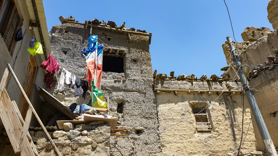 Colourful prayer flags on the rooftops of a building