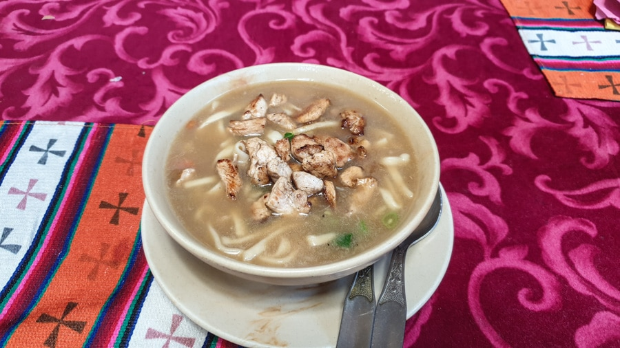 A bowl of soup, noodles and meat