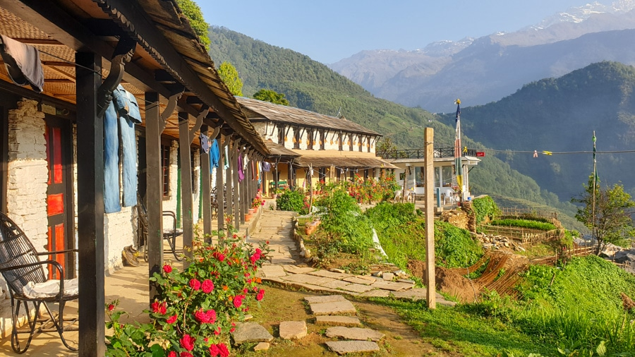 A rustic guesthouse overlooking mountains in Ghandruk