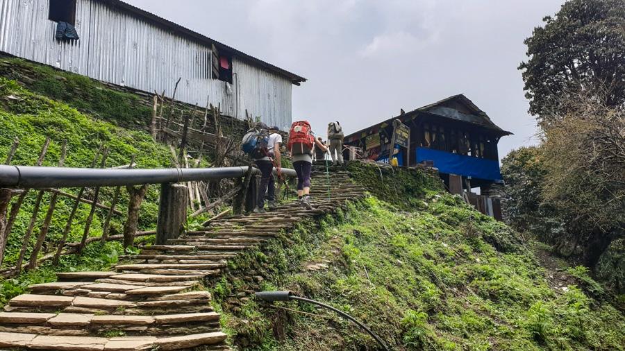 Hikers climbing steps near a village of Ban Thanti