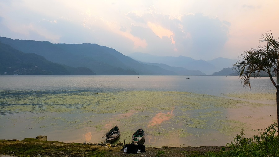 Two boats at sunset on the shore of Phewa Lake in Pokhara
