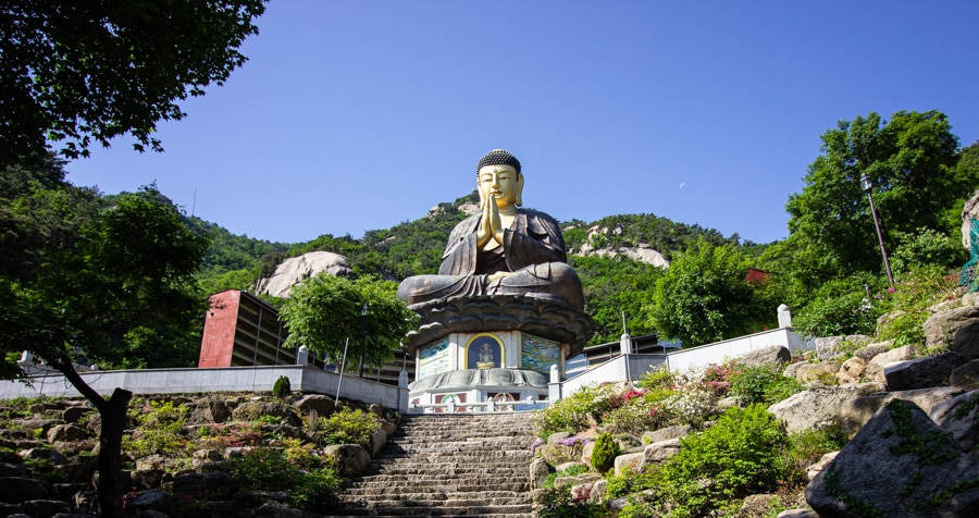 A giant golden statue of a sitting buddha in Bukhansan National Park